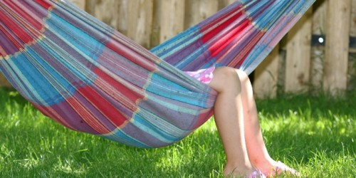 Little girl having a rest in a hammock